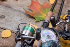 Fishing tackles on board with leafs autumn Royalty Free Stock Image