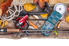 Fishing tackles on board with leafs of autumn Stock Image