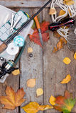 Fishing tackles on board with leafs of autumn Stock Photos