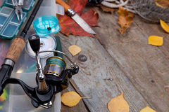 Fishing tackles on board with leafs of autumn Royalty Free Stock Image