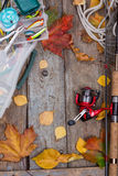 Fishing tackles on board with leafs of autumn Stock Images