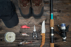 Fishing tackles and fishing gear on wooden background Stock Photography