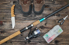Fishing tackles and fishing gear on wooden background. Top view Royalty Free Stock Photos