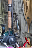 Fishing tackles with fishing vest and boots Stock Images