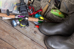 Fishing tackles with fishing vest and boots Royalty Free Stock Image