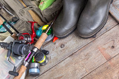 Fishing tackles with fishing vest and boots Stock Photography