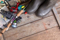 Fishing tackles with fishing vest and boots Royalty Free Stock Photos