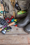 Fishing tackles with fishing vest and boots Royalty Free Stock Photography
