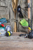 Fishing tackles with fishing vest and wooden Stock Photo