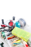 Fishing tackles and lure in storage boxes Stock Image