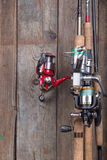 Fishing tackles on old wooden board Royalty Free Stock Photography
