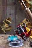 Fishing tackles on old wooden board Stock Photos