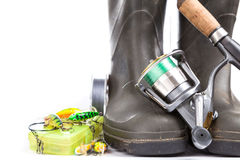 Fishing tackles and rubber boots on white Stock Photography