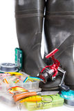 Fishing tackles and rubber boots on white Stock Photos