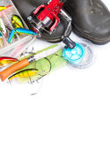 Fishing tackles and rubber boots on white Royalty Free Stock Photos