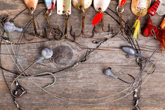 Fishing tackles and spoon on wooden Royalty Free Stock Image
