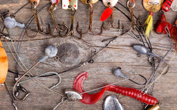 Fishing tackles and spoon on wooden Stock Photo
