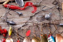 Fishing tackles and spoon on wooden Royalty Free Stock Photos