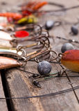 Fishing tackles and spoon on wooden Royalty Free Stock Images