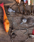 Fishing tackles and spoon on wooden Stock Photos