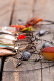Fishing tackles and spoon on wooden Royalty Free Stock Photography