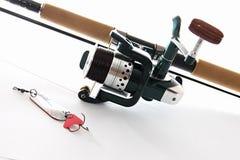 Fishing tackles. Sportfishing equipment on white Royalty Free Stock Photos