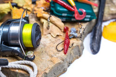 Fishing tackles on stones with anchor and leafs Stock Photography