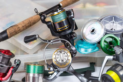 Fishing tackles in storage box Stock Images