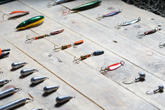 Fishing tackles on the wooden background. Fishing original tackles on the wooden background Royalty Free Stock Image