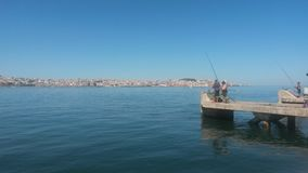 Fishing in Tagus river Royalty Free Stock Photos