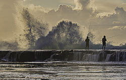 Fishing Thrill seekers. Local fishing area called Flat rock Royalty Free Stock Image