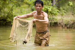 Fishing with a throw net. In the Asian space is often combined with a throw net fishing stock photos