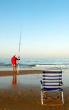 Fishing time. On the ocean beach Stock Photo