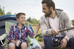 Fishing together. Can I ask you something daddy Stock Photography
