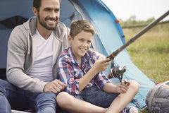 Fishing together. Leisure activity on the summer camping Stock Photography