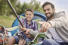 Fishing together. Look! You have almost caught this fish Stock Image