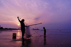 Fishing together in the sunrise Royalty Free Stock Photography