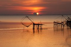 Fishing tool and sunrise Stock Photos