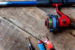 Fishing tackle on a wooden surface royalty free stock photos