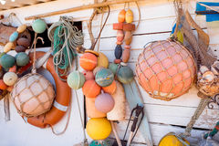 Fishing tools hanging outdoors Royalty Free Stock Photo