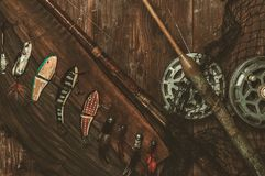 Fishing tools on a wooden table Stock Photo