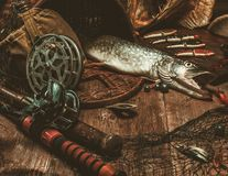 Fishing tools on a wooden table Royalty Free Stock Photos