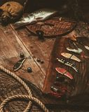 Fishing tools on a wooden table Stock Image