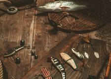 Fishing tools on a wooden table Stock Images