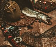 Fishing tools on a wooden table Royalty Free Stock Image