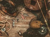 Fishing tools on a wooden table Royalty Free Stock Photo