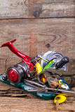 Fishing and tourism gear on timber board Stock Photos