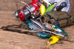 Fishing and tourism gear on timber board Stock Image