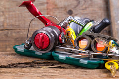 Fishing and tourism gear on timber board Stock Photo