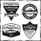 Fishing tournament set of four vector emblems. Fishing tournament set of four emblems, labels, badges or logos in vintage style on white background with texture Royalty Free Stock Photography